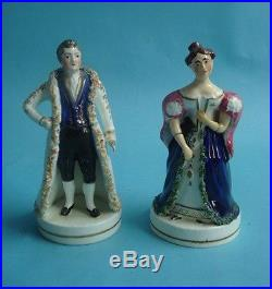 A PAIR OF STAFFORDSHIRE FIGURES OF PRINCE CHARMING CINDERELLA