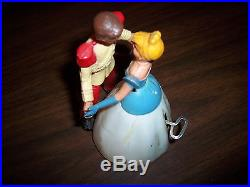 ANTIQUE CINDERELLA AND PRINCE CHARMING WIND UP DANCING TOY